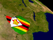 Zimbabwe with flag on Earth Stock Photo