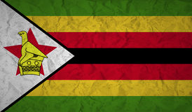 Zimbabwe flag with the effect of crumpled paper and grunge Stock Photography