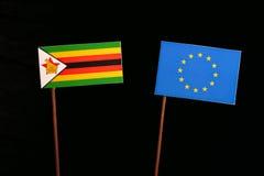 Zimbabwe flag with European Union EU flag  on black Royalty Free Stock Images