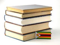 Zimbabwe flag with pile of books isolated on white background. Zimbabwe flag with pile of books isolated on white Royalty Free Stock Photography