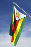 Zimbabwe flag and sky stock photography