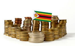 Zimbabwe flag with stack of money coins Royalty Free Stock Images