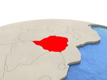Zimbabwe on globe with watery seas. Zimbabwe highlighted in red on globe with realistic blue water. 3D illustration Stock Photography