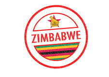 ZIMBABWE. Passport-style ZIMBABWE rubber stamp over a white background Royalty Free Stock Photography