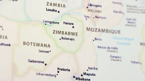 Zimbabwe on a Map. Zimbabwe on a political map of the world. Video defocuses showing and hiding the map stock video footage