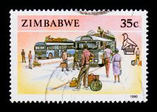 Zimbabwe postage stamp shows Buses and Passangers, Animals, Hand Crafts and Transportation serie, circa 1990 Stock Photography