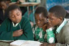 Zimbabwe Students. July 30, 2007 - Students at a primary school in Mutoko, Zimbabwe,  study after a lunch provided by an international humanitarian agency to the Stock Photography