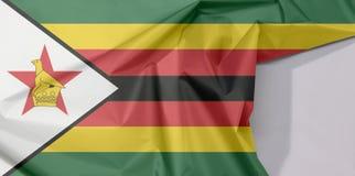 Zimbabwe tkaniny flaga zagniecenie z biel przestrzenią i krepa fotografia royalty free