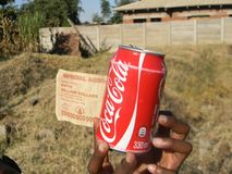Zimbabwean $50 billion  bill and  can  of  coke. Harare.,May 31 2016. Iluustrated editorial of  Zimbabwean $50 billion bill  and  a  can of  coke  it  could Royalty Free Stock Images