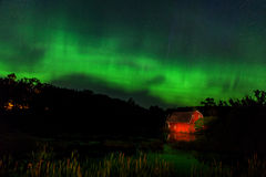 Zimmerman Aurora. The Aurora Borealis over the sinking barn in Zimmerman Minnesota Royalty Free Stock Images