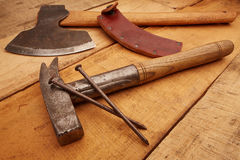 Zimmermann ax and hammer Latt. Carpenter Tools on rustic wood Stock Photo