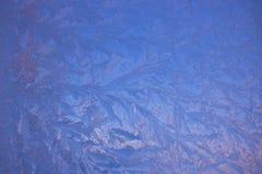 Zimno mrozu wzory na szkle fotografia stock