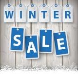 Zimy ceny sprzedaży majcherów Drewniany tło Obrazy Stock