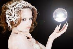 Zimy princess i magiczna kula ziemska Obraz Royalty Free