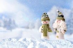 Zimy przyjazdowy pojęcie z dwa bałwanem Obrazy Stock