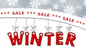 Zimy sprzedaż - drzejący papier z tekstem, listy wiesza na taśmach Obrazy Royalty Free