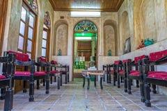 Zinat ol Molk House Tearoom. SHIRAZ, IRAN - MAY 2, 2015: Zinat ol Molk House tearoom with chairs it was a private house now turned into a museum Royalty Free Stock Photos