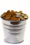 Zinc bucket of gold coins on a white background. Royalty Free Stock Image