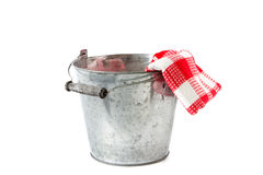 Zinc bucket with red checkered tea towe Royalty Free Stock Photo