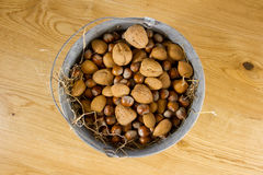 Zinc bucket with straw full of mixed nuts Royalty Free Stock Photo