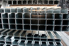 Zinc coated profile. Stell zinc coated profiles in the rack Royalty Free Stock Photos