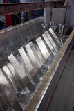 Zinc coating. Process of steel hot dip galvanizing Royalty Free Stock Photo