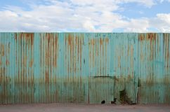 Zinc fence on blue sky Royalty Free Stock Images