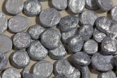 Zinc granulate. Grains of zinc granulate for metal production Stock Photos