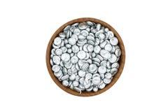 Zinc granules wooden bowl Stock Photography