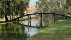 Zinc Lakes in Broken Hill. This beautiful man made lake allows for picnics, barbeques and family outings. This beautiful bridge has seen many photos take stock photos