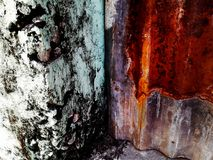 Zinc and mortar Grunge metal surface with paint and rust, background. Buildings.  stock photos