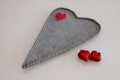 Zinc plate and red hearts. Zinc heart plate and red hearts Stock Photo