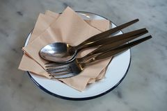 Zinc plate and tissue fork and spoon serve for meal stock images