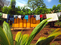 Zinc sheet metal house  jungle with laundry drying Quinn Hill Bi. Zinc sheet metal house in jungle with laundry drying Quinn Hill Big Corn Island Nicaragua Stock Photography