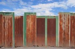Zinc staket på blåttskyen Royaltyfria Foton