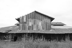 Zinc wall rusty corrugated metal thailand ancient home decay nature. Black and white tone Stock Photo