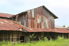 Zinc wall rusty corrugated metal thailand ancient home decay nature.  Royalty Free Stock Photos