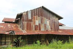 Zinc wall rusty corrugated metal thailand ancient home decay nature.  Royalty Free Stock Image
