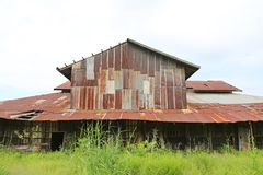 Zinc wall rusty corrugated metal thailand ancient home decay nature.  Royalty Free Stock Photo
