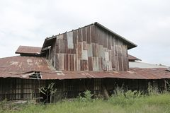 Zinc wall rusty corrugated metal thailand ancient home decay nature.  Royalty Free Stock Images
