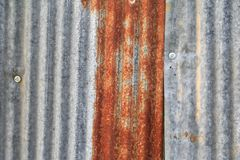 Zinc wall texture pattern background rusty corrugated metal old decay.  Stock Photo