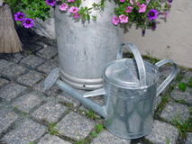 Zinc watering can in garden Royalty Free Stock Photography