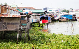 Zinc and wood house on river Royalty Free Stock Photo