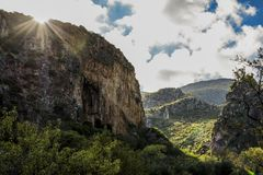 Zingaro Nature Reserve - sun rays and mountain. stock photos