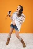 Zingende Zwangere Vrouw Stock Afbeeldingen