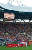 Zingt het nationale de voetbalteam van Denemarken hymne Stock Fotografie