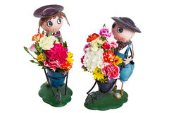 Zinkpuppe mit bunter Blume Stockbild