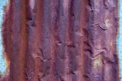 Zinkroest Zinktextuur en Achtergrond De oude muur van het schade roestige zink plat stock afbeeldingen