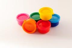 Zinn mit Farben Stockfotos