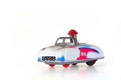 Zinn-Spielzeug-laufendes Auto Stockbild